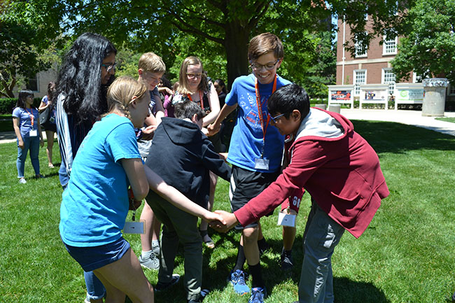 SIM camp students participate in the human knot activity.