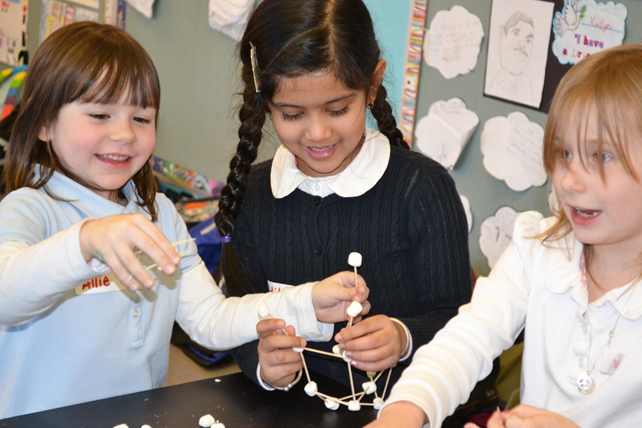 Three BTW students enjoy making their marshmallow/toothpick tower