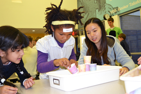 Yang Han works with two BTW students on a project automating a hot chocolate mixing design.