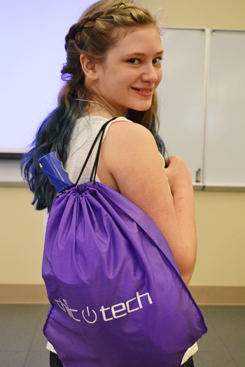 ChicTech participant shows off her Swag Bag.