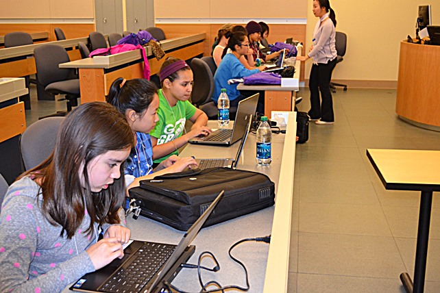 Young women use Scratch during the 'Make an Animation' workshop