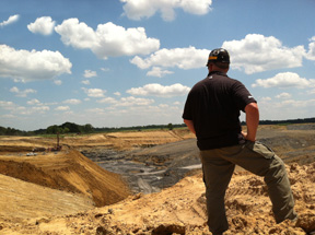 Miner views surface coal mine in southern Illinois.