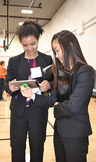 Niya Mitchell (left) signs up to chat with one of the recruiters