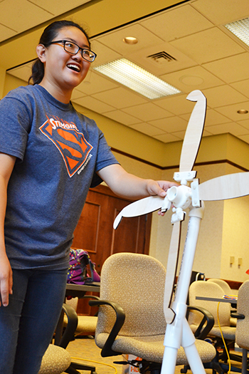 A GBAM G.A.M.E.S. camper adjusts her team's windmill during the competition the final day of camp.