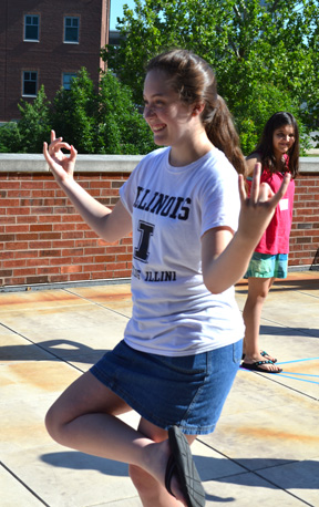 Briana Chapman strikes a unique pose as part of a human graphs activity during GEMS camp.