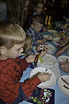 A group of youngsters make DNA structures out of candy at the Delicious DNA activity booth.