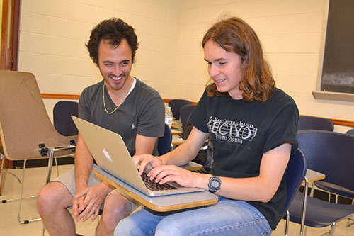 Caption: James Schmidt interacts with a Uni High student doing research about theorems and conjectures.