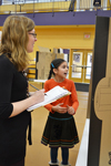 Psychology Professor Kara Federmeier evaluates an NGS student's presentation during the fair.