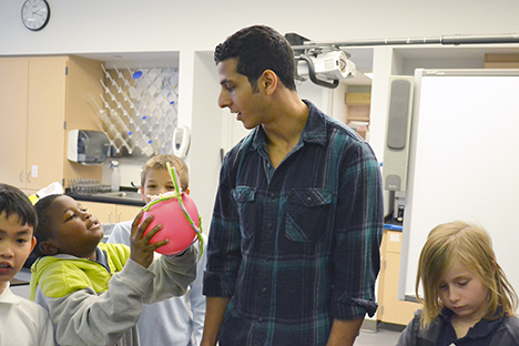 An Illinois grad student interacts with a BTW student during a NanoSTRuCT session.