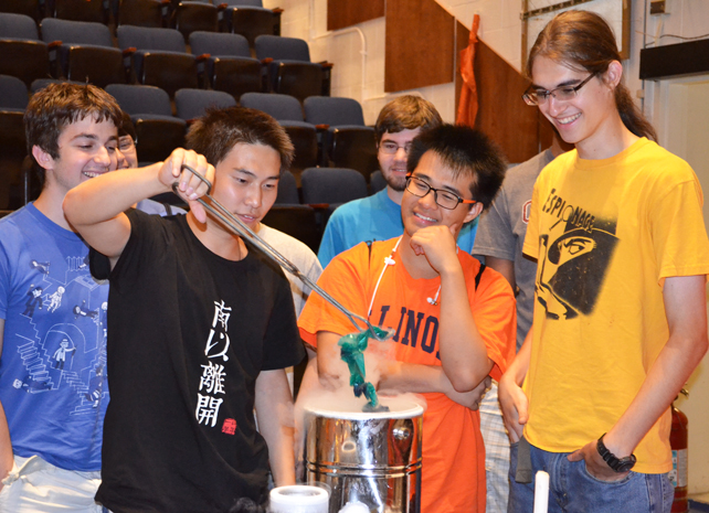 Physics Van trainees successfully perform the demo in which a baloon is placed in liquid nitrogen, causing the air in the balloon to contract and the balloon to shrivel.