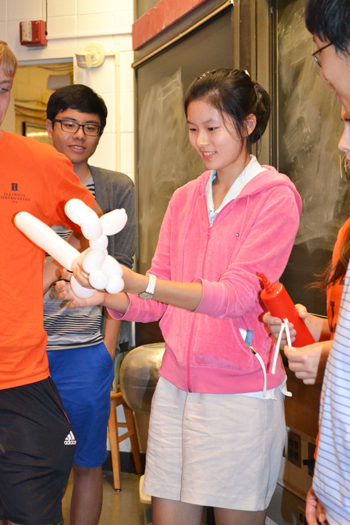Van trainee displays her skill at creating balloon figures, which trainees would dip in liquid nitrogen.
