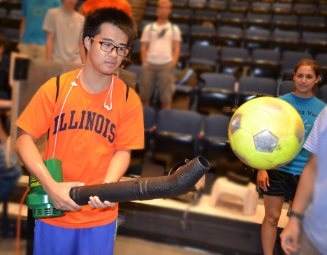 Physics Van trainee balances a ball on a blast of air.