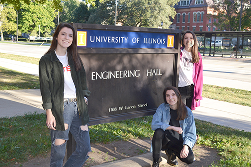 (right to left) Mary, Theresa, and Frances in front of the Engineering Hall sign.