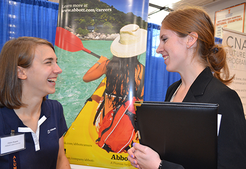 Emily Matijevich (right) chats with  Abbott recruiter Claire Slupski