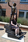 Amy Doroff sitting in front of the Quintessential Engineer statue.