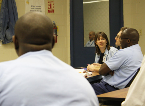 Sarah Lubienski (center) interacts with an EJP scholar while teaching a workshop at Danville Correctional Center.