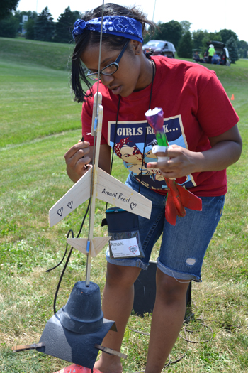 Aerospace Engineering G.A.M.E.S. camper prepares her glider for launch.