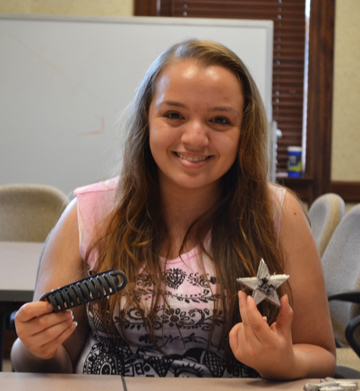 G-BAM camper Stephanie Smithson displays the items she made during some of the hands-on activities.