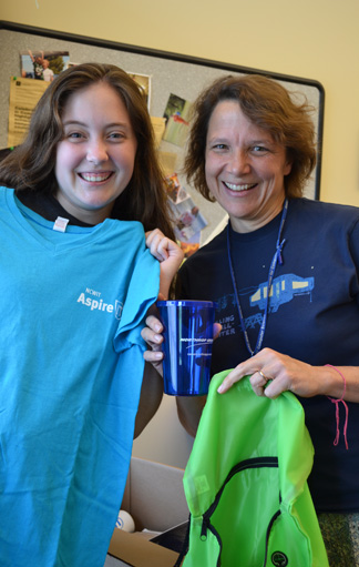 Briana Chapman and Cinda Heeren show off some of the goodies they received from the girls from NCWIT.