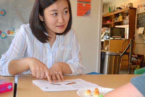 Lili Cai explains to a youngster about molecules.