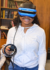 A Franklin student experiences virtual reality during the students' visit to MRL.