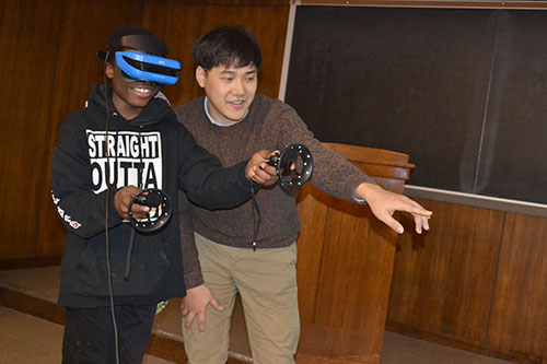 I-MRSEC's Kising Kang introduces a Franklin student to Virtual Reality (VR).