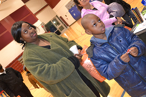 Shamari Graham and her son, John Whittle, wait expectantly to see if his raffle number is called.