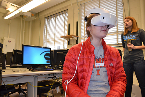 At SWE's spring 2018 Introduce-a-Girl-to-Engineering Day, a high school student experiences the human brain during BMES's virutal reality session.