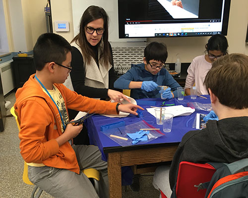 Holly Golecki (second from the left) works with Uni High students doing soft robotics hands-on activities. (Image courtesy of Holly Golecki.)