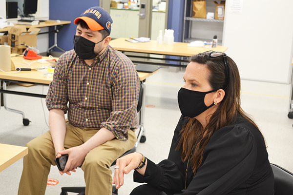 Elisandro Cabada and Holly Golecki chat with the 3D Bioprinter team during their demonstration.