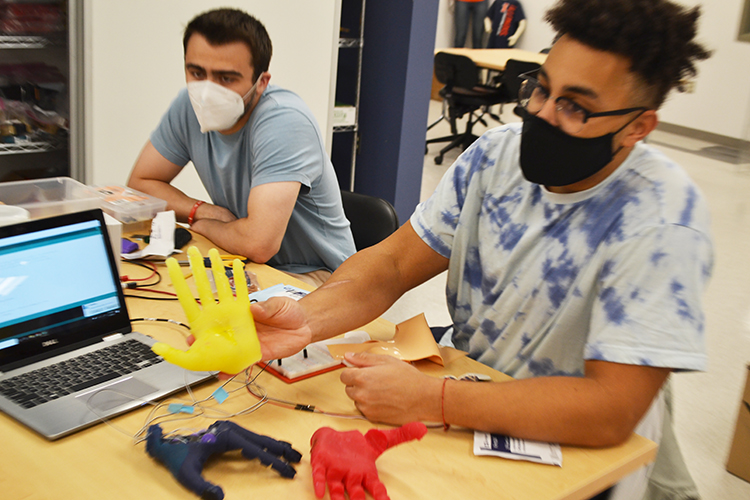 Riley Lehmann and Preston Njapa Njeuha demonstrate their Prosthetic Robotic Hand.