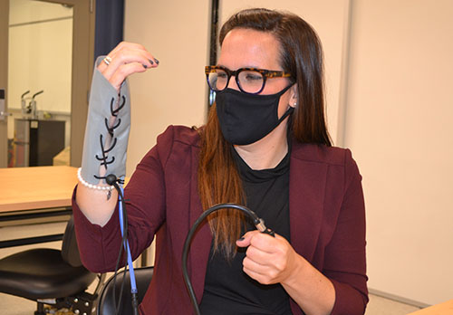 In a recent BioE class, Holly Golecki demonstrates how the Soft Robotics Toolkit wrist brace works.