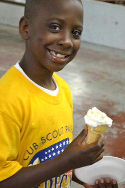 Young cub scout enjoys his ice cream made with liquid nitrogen.