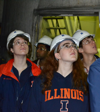 CEE 398 students examine Abbott Power Plant's smoke stacks during a tour of the power plant.