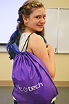 ChicTech participant proudly displays her Swag Bag.