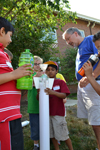 Uni High summer campers and Bob Coverdill prepare to launch bottle rocket.
