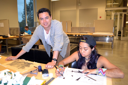 David Emmons looks at a student's work during one of the camps hands-on sessions.