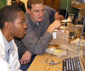 Christopher Schmitz works with ECE 101 student during class lab.