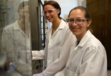 Emily Rabe and post-doc researcher Dawn Ernenwein work on HPG research.