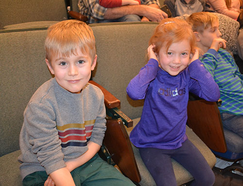 Two local youngsters enjoying Chemistry's 2019 edition of the Holiday Magic show.