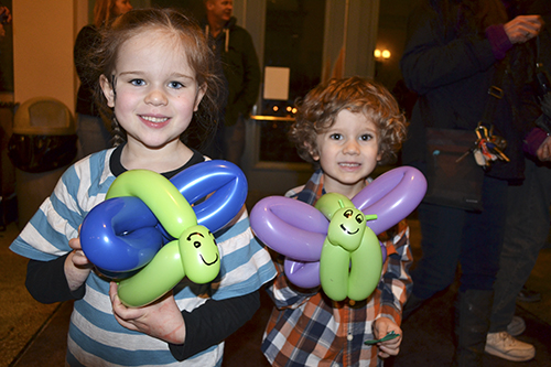 Two young visitors show off the balloon butterflies they got at the IFFF