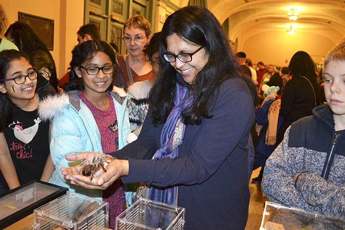 A mother overcomes her fears and holds a tarantula at the EGSA petting zo