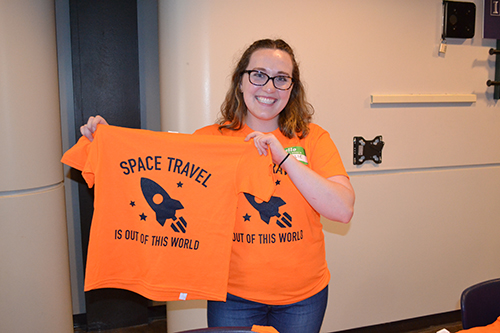 ISS PR manager Natalie Pfister shows off the t-shirt they designed for ISD.