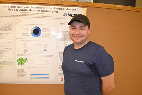 An INCLUSION REU participant, Patrick Shinn, by his poster about building a framework for data collection for semiconductor nanocrystals.
