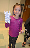 A young visitor exhibits the model she made of graphene for flexible electronics.