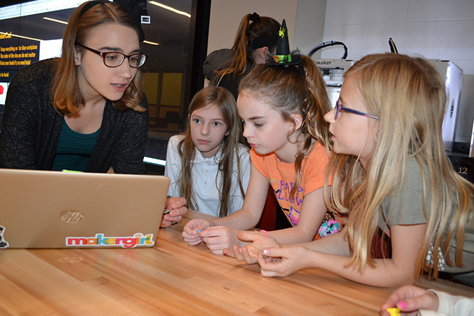 Amy Merkelz discussed 3D printing with young visitors.