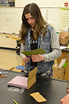 A Monticello Middle School student assembles here teams incubator.
