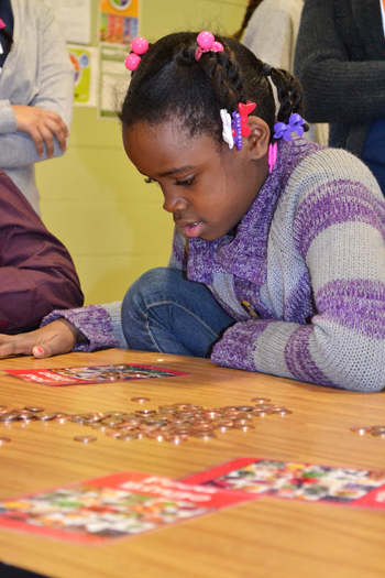 A youngster at Prairie Elementary learns about nutrition while playing bingo.