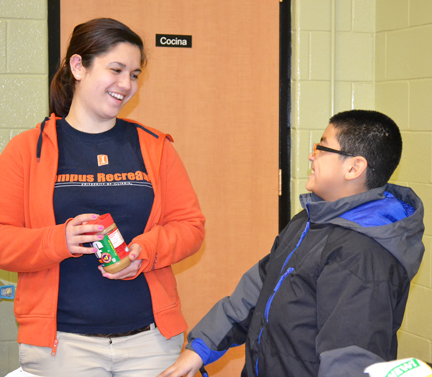Leila Shinn discusses nutrition with a Prairie Elementary School student.
