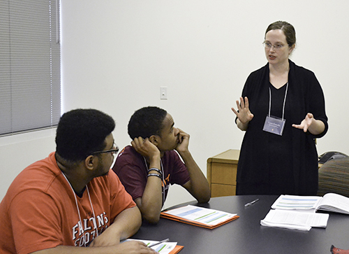 Left to right: David Alexander and Solomon McBride listen as Carrie Kouadio explains the EBICS REU components during the REU Orientation at the beginning of the summer